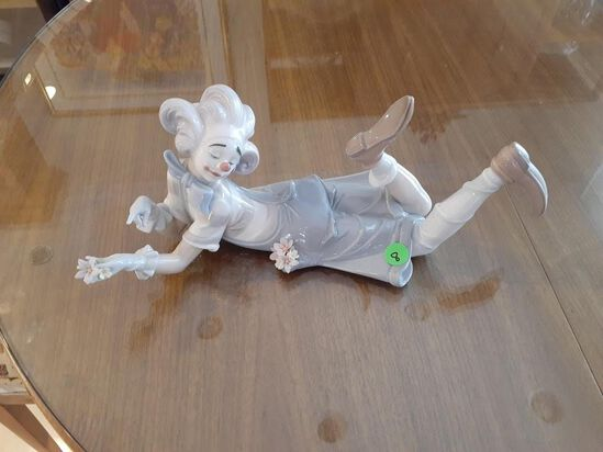 Lladro Clown laying down holding flowers