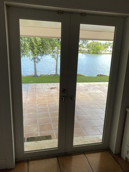 """56""""W x 77""""H Metal Framed French Doors with Stainless Steel Knob Set"""