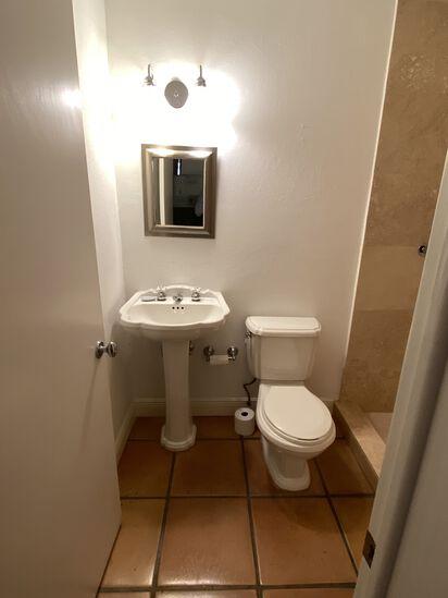 Complete Bathroom including: Pedestal Sink, American Standard Toilet, Mirror and two Bulb Vanity Lig
