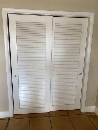 (2) Slide Door Louvre Doors and Interior Closet System