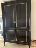 Large Modern Armoire with sleek lines and a modern feel this Cabinet has an upper Television Compart