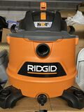 Rigid Wet and Dry Vacuum with 6 H.P. Motorcomes with box and attachments (used on once)