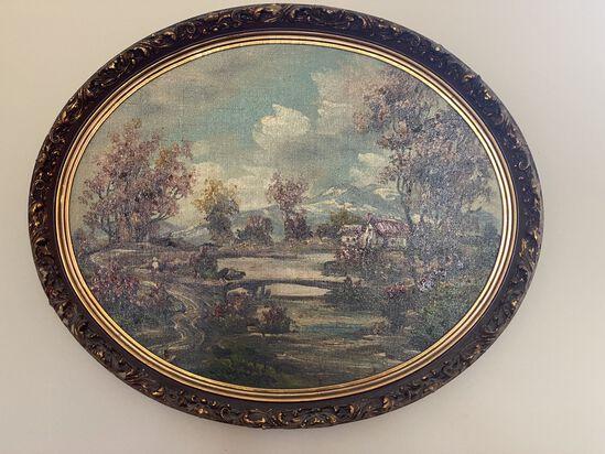 Oval Shaped Gold Framed Artpiece
