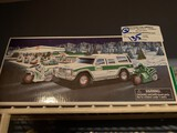 (4) New, Boxed Hess Vehicles, (3) Trucks & (1) Helicopter