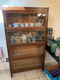 A 4 Shelf Bookcase with Sliding Glass Doors