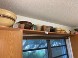 Contents of Ceramics and Pottery on Shelfs in Laundry Room