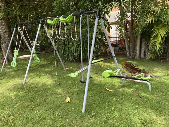 Large Metal Swing Set With Two Swings, Seesaw, Two Or Three Other Types Of Entertainments