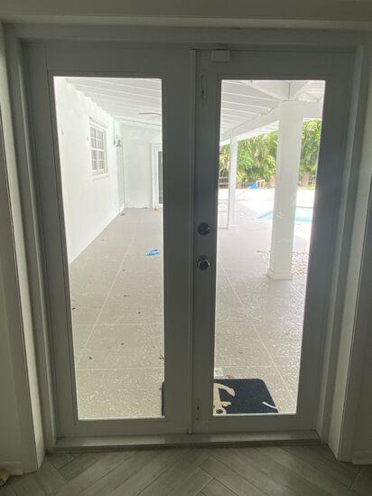 """54"""" Double Entry Door Way With Impact Glass Panels On Each Door, A Brushed Nickel Door Lock And Door"""