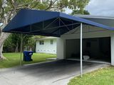 Approximately 17' x 20' Blue Canvas Carport Awning For Two Cars. Welded Interior Structure. Very Stu