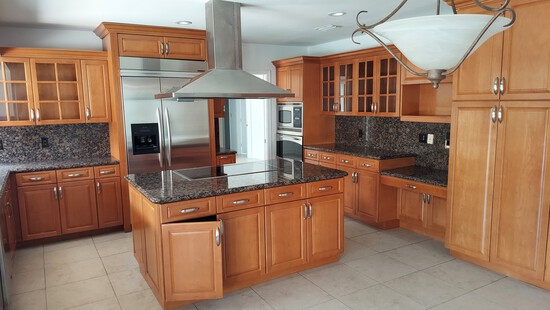 """131"""" x 76"""" """"L"""" Shaped Cherry Wood Kitchen With Glass Door Illuminated Cabinets and Granite Counterto"""