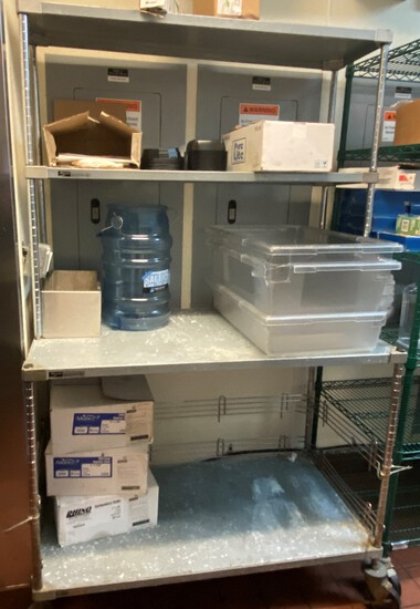 """48"""" Metro Rack with Table and Undershelf and Double Overshelf The Unit is mounted on Casters"""