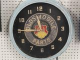 VINTAGE ROUND OLDSMOBILE PARTS LIGHTED CLOCK- 19