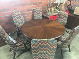 ROUND MAHOGANY TABLE AND 8 CHAIRS FLAME STITCH UPHOLSTERED BACK AND SEAT, CURVED WOODEN ARMS