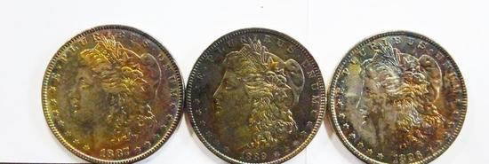 (3) NICELY TONED MORGAN SILVER DOLLARS IN CASE