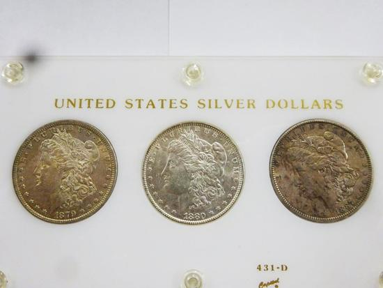 (3) MORGAN SILVER DOLLARS ENCAPSULATED IN DISPLAY, AU-BU CONDITION -