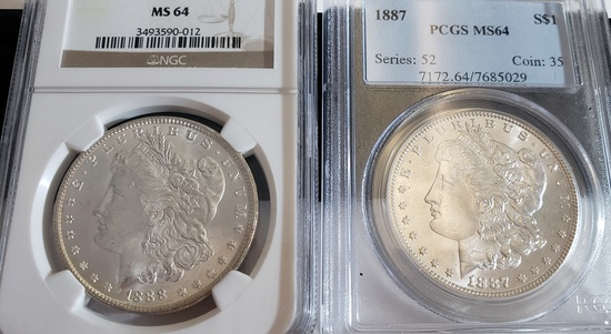 (2) GRADED MORGAN SILVER DOLLARS
