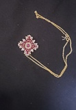 14KT GOLD, RUBY AND DIAMOND PENDANT/ENHANCER, FORMED IN A CROSS DESIGN