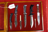 GLASS TOP DISPLAY OF VARIOUS BOWIE KNIVES
