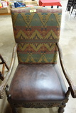 LEATHER AND UPHOLSTRY ARM CHAIR WITH CARVED ARMS AND LEGS
