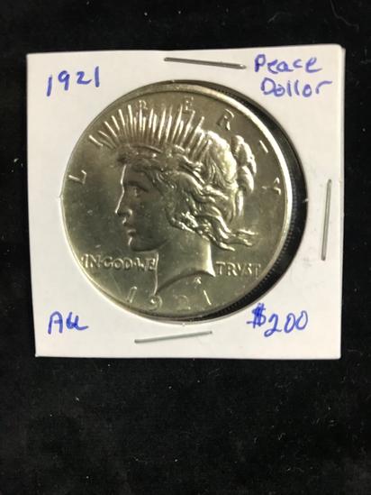 AU 1921 PEACE SILVER DOLLAR