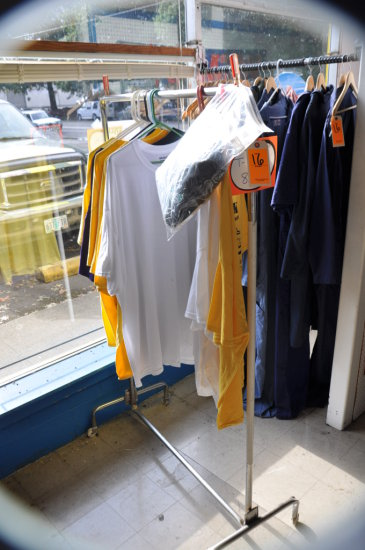 RACK WITH T-SHIRTS AND ASSORTED COVERALLS