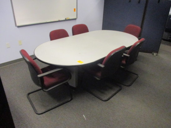 GRAY CONFERENCE TABLE OVAL APPROX 8'L C/W 9 RED PADDED BLACK FRAME CHAIRS