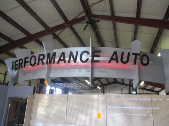 ''PERFORMANCE AUTO'' LIGHTED OVERHEAD SIGN
