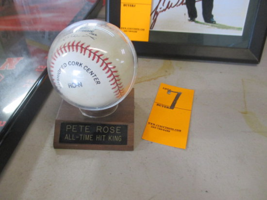AUTOGRAPHED BASEBALL BY PETE ROSE IN PLASTIC CASE