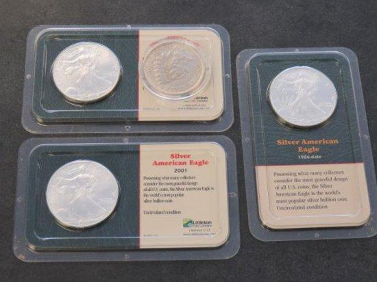 (3) UNCIRCULATED SILVER AMERICAN EAGLE COINS & (1) 1851 FAKE USA SILVER DOLLAR