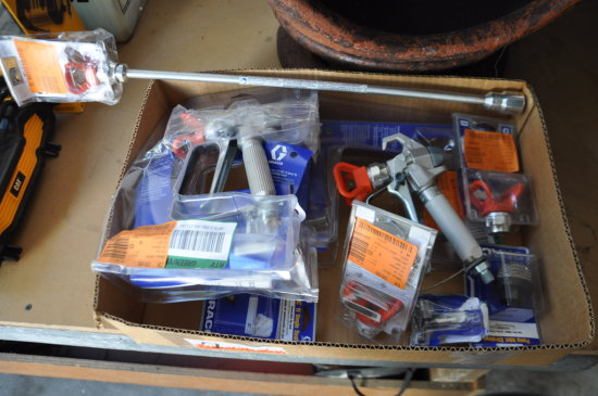 LOT 2 GRACO AIRLESS GUNS AND ASSORTED TIP PARTS