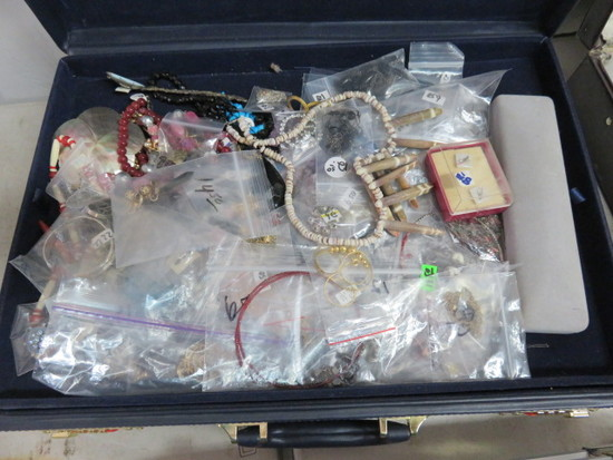 BRIEF CASE CONTAINS MOSTLY COSTUME JEWELRY