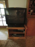 RCA TV, (2) VHS PLAYERS & ENTERTAINMENT STAND