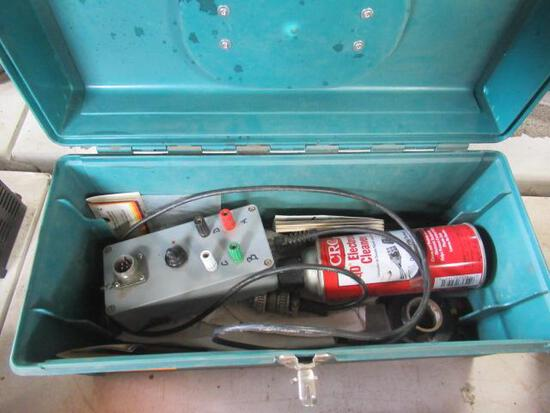 Green plastic tool box of wiring items