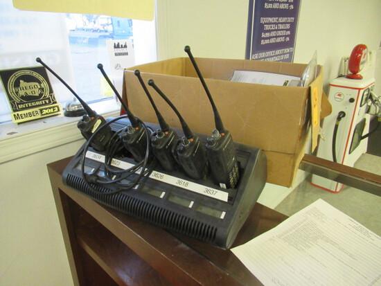 (5) MOTOROLA MTX8250 RADIOS, CHARGING STATION & BOX OF ACCESSORIES