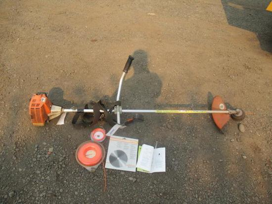 STHIL GAS POWERED STRING TRIMMER W/ EXTRA STRING & SAW BLADE ATTACHMENT (OWNERS MANUAL & EXTRA