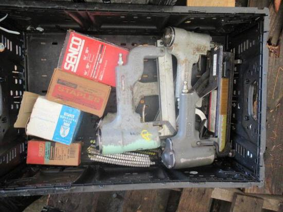 PLASTIC CRATE W/ (5) PNEUMATIC NAIL / STAPLE GUNS & BOXES OF NAILS / STAPLES