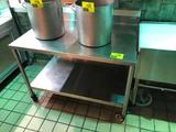 4' x 2-1/2' portable stainless steel table with backsplash and undershelf