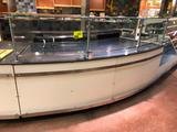 Curved hard top bakery service counter wit glass guard (Approx. 15')