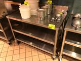 4' x 2' portable stainless steel table with backsplash and undershelf