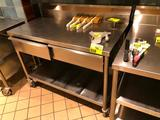 4' x 2' portable stainless steel table with backsplash, drawers, and undershelf