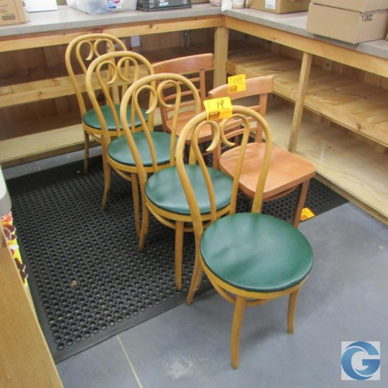 Wood chairs with green vinyl seats