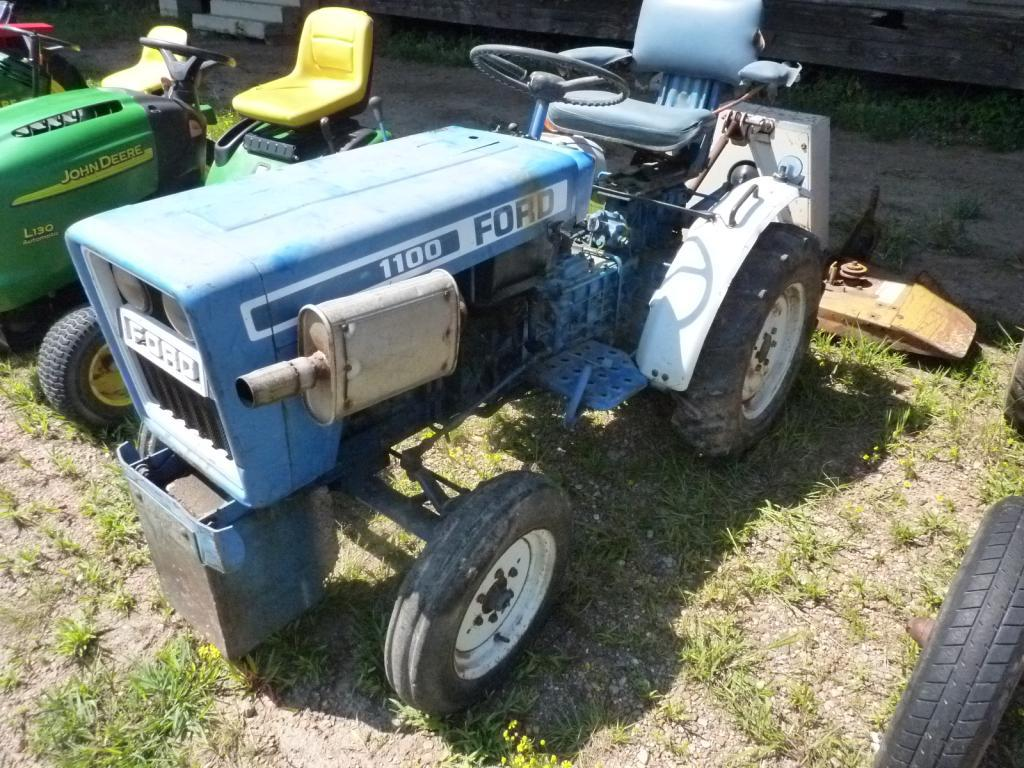 Lot: Ford 1100 Tractor w/Woods RM59 Finish Mower | Proxibid Auctions