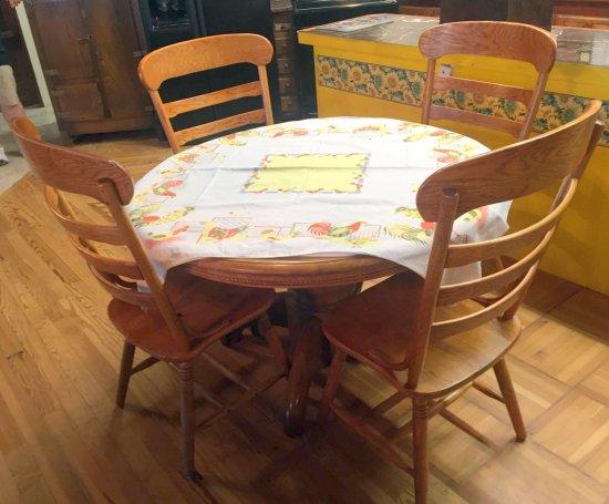 "48"" round oak pedestal table w/ 4 pattern back chairs"