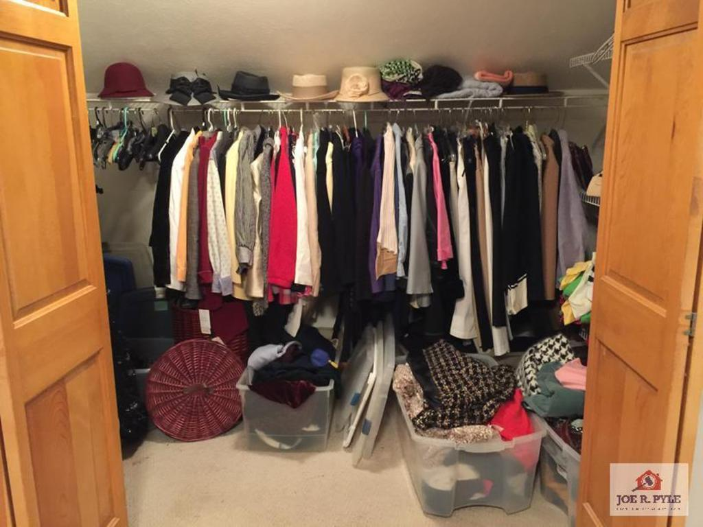 Contents of closet: ladies clothing and accessories