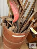 Barrel of hand tools, shovels, brooks rake, hammer