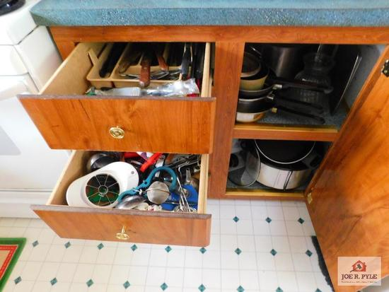 Contents of cabinet: Crock pot, pots, pans, flatware and kitchen utensils
