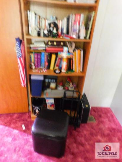 Bookshelf and contents: books decorative items, footstool