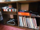 Entertainment stand with LPs: John Denver, Johnny Cash, Fleetwood Mac
