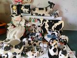 Large collection of cow decorative items