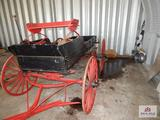 Red and black covered wagon